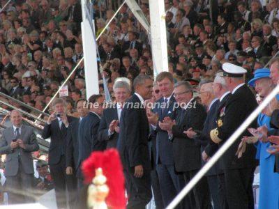 Barack Obama reaching his spot next to Giorgio Napolitano